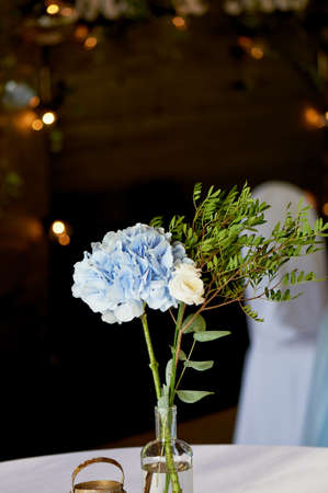 hydrangea macrophylla: Stylish, fashionable wedding arch ceremony decorated with blue and white different flowers. Floral Design. Summer restaurant outdoors by preparation for wedding background on the river or sea.