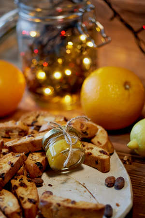 Cookie biscotti, a jar of honey and fruit. The atmosphere of warmth and coziness. New year atmosphere