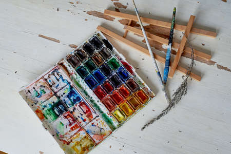 palette with watercolor paint. Not new, artistic designs. Creative space of the artist
