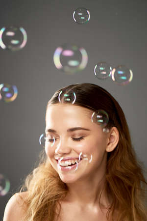 Portrait of young beautiful girl in Studio, with professional makeup. Beauty shooting.Bubble. Atmosphere of lightness, childhood Banco de Imagens