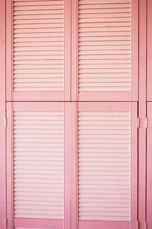 Texture pink doors blinds made of wood. Reklamní fotografie