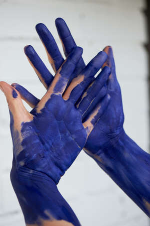 Hands in blue paint, the hands of the artist and creative person. Yoga for the hands. Foto de archivo - 123523179