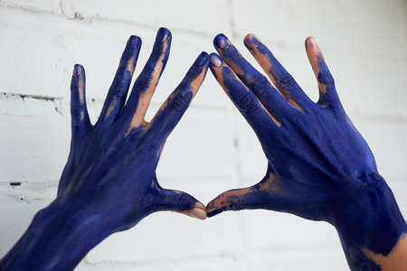Hands in blue paint, the hands of the artist and creative person. Yoga for the hands. Foto de archivo - 123523181