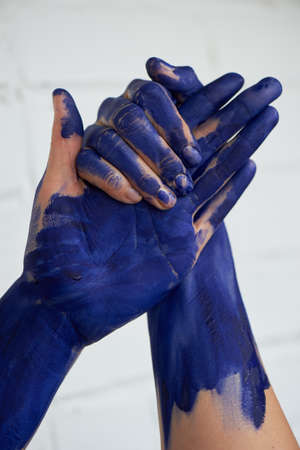 Hands in blue paint, the hands of the artist and creative person. Yoga for the hands. Foto de archivo - 123525226