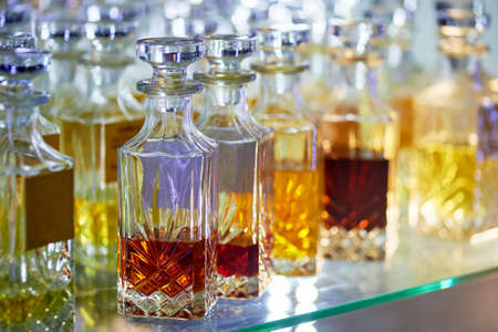 Glass perfume bottles based oils. A Bazaar, market. Aroma oils, oil perfume in faceted glass vessels. Stock Photo