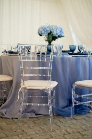 Wedding decoration of the Banquet hall for the wedding in blue. Hydrangea.Transparent chairs.