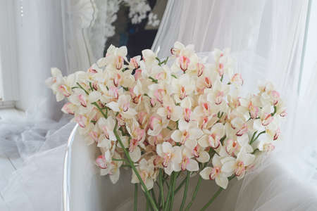 Lots of orchids and white chiffon. Decorative floral design.