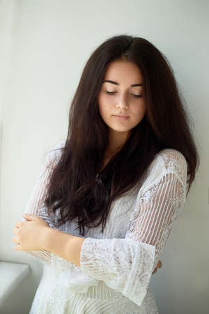 A girl with dark eyebrows , brown eyes and dark hair. Natural beauty. Thick wide eyebrows.