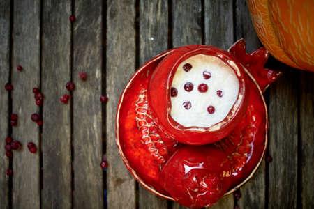 Red ceramic, handmade. Shaped like a grenade. Stock Photo