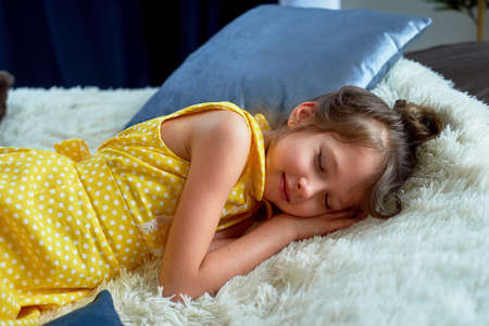 A 6-year-old girl in a yellow dress. I fell asleep with my clothes on. Fatigue from playing and brain activity. I was starved.
