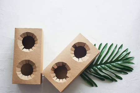 Disposable cardboard coasters. Fastwood, takeaway food. A drink stand.