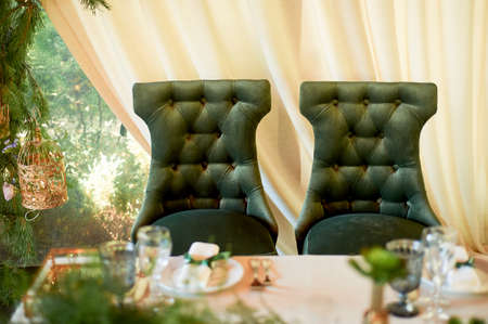 Two green chairs lined with green velvet. Gorgeous, palace style.