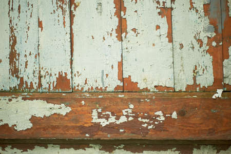 Texture of old wooden boards with peeling paint. A fence or a wall of a house. Standard-Bild