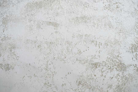 Grey textured wall with decorative plaster. Texture with space for text