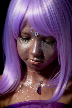 A girl with purple hair and glowing skin. An alien or a fairy with glowing skin.