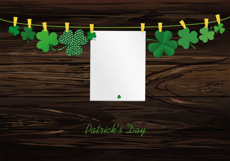 Petals of clover with a picture hanging with paper blank on a rope with clothespins. St.Patrick 's Day. Vector illustration. Greeting card with empty space for text or advertising. On a wooden background.
