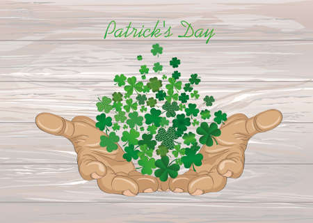 The gesture of the open hands. From the hands of fly sheets clover. Patricks day. Greeting card. Vector illustration. Empty space for text labels and advertising. On wooden background.