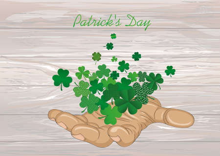 The gesture of the open hand. From the hands of fly sheets clover. Patricks day. Greeting card. Vector illustration. Empty space for text labels and advertising. On wooden background.