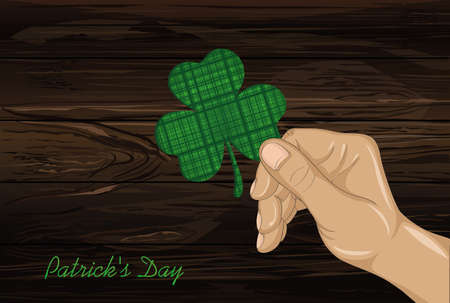 Hand holds ornate clover four-leaf. Celebration concept St. Patricks Day. Greeting card. Vector illustration on a wooden background. Free space for your text and labels. Illustration