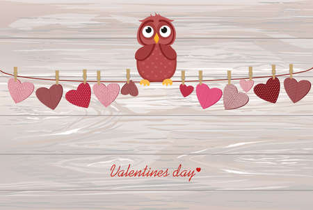 Cute colored owlet sitting on a string. A red hearts with a picture hanging on a rope. Valentines Day. Vector illustration. Greeting card with empty space for the label or advertising. On wooden background.