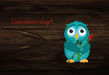 Cute blue owlet waiting to give a of flower red rose with empty space for your text or advertisement on a wooden background.