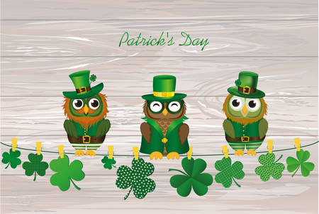 Three owls in the national costume for day Patrick sitting on a rope with Petals of clover with the paper blank. Three-leaf on clothespins. Vector illustration on wooden back. Greeting card with empty space for text or ad.