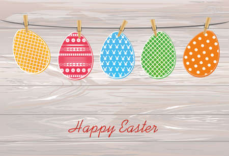 Multicolored Easter eggs with wings hang on a rope on clothespins. Celebration. Greeting card. Free space for text. Vector illustration on wooden background. Vettoriali
