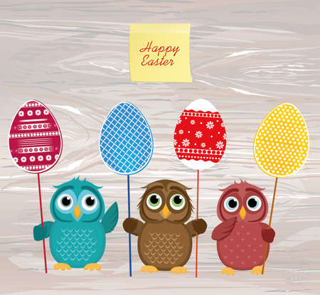 Owls keep Easter decorated eggs on a stick. Multicolored.  Empty Yellow sheet of paper for notes. Sticker. Vector on wooden background. Greeting card for the holiday. Empty space for text.