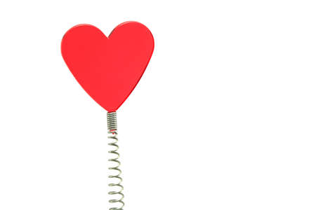a red glass heart on a spring - novelty placemarker photo