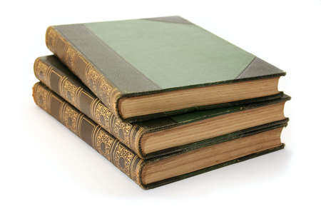 hard cover: Three antique hard cover books - part of a childrens encyclopedia set from the 1900s.  Stock Photo