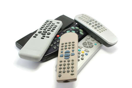 remote controls: various TV and video remote controls collecting dust around the house