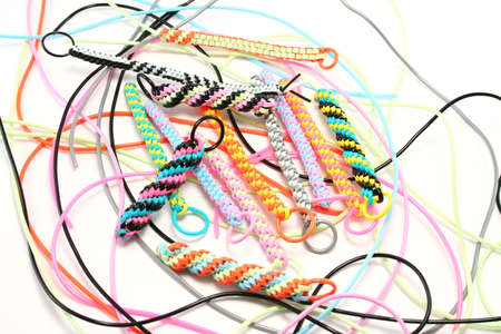 craze: Plastic strings used to make scoubies (boondoggles in USA). Recent craze in UK to make zip pulls, keyfobs etc
