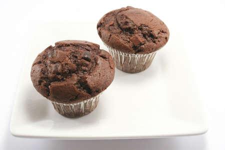 two tasty choc chip and choc sponge muffins - Double Choc heaven! photo