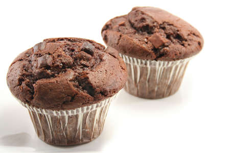 two tasty chocolate muffins, focus on front one photo