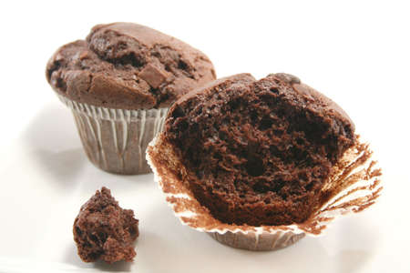Double choc chip muffins with one half eaten photo