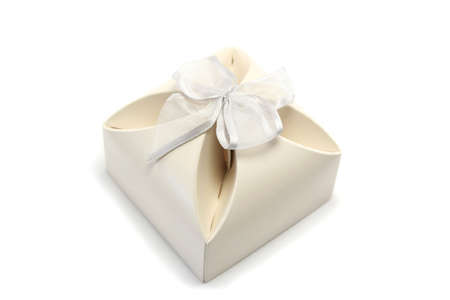 small gift box in cream cardboard with a slivery bow - often used for wedding favours