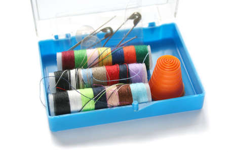 Little blue plastic box with emergency sewing supplies - needles, pins, threads, thimble and buttons Stock Photo - 4766806