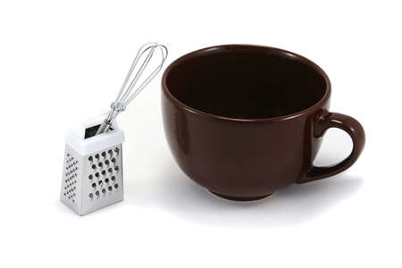 cappuchino: large brown cappuchino coffee mug with chocolate grater and mini whisk Stock Photo
