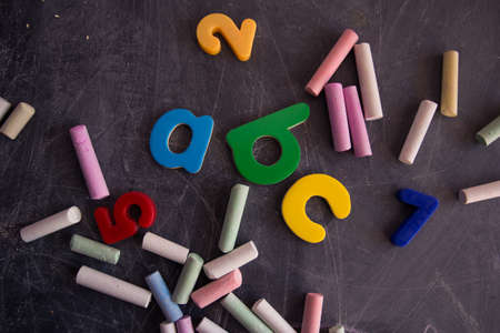 colored chalks numbers and letters on the blackboard photo