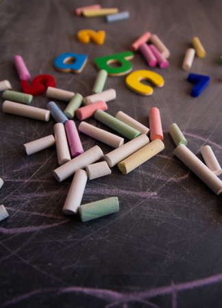 chalks: colored chalks numbers and letters on the blackboard