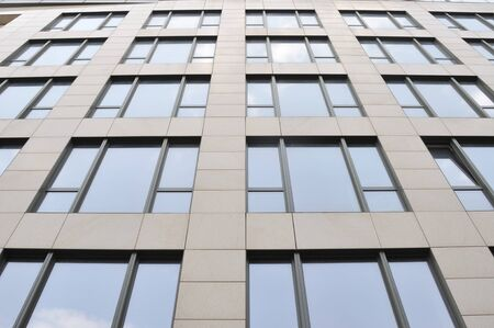 wall of the building with set of the windows with reflection sky Reklamní fotografie