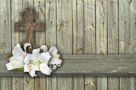 christian cross and three white lily on wood grey background Reklamní fotografie - 76838096