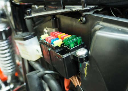 fuse: Fuse box of motocycle. It has fuse too. Many color of fuse show its bright.