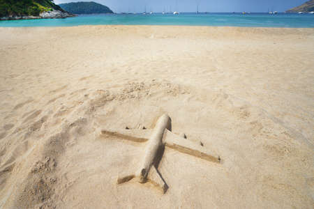 desolated: airplane fashioned from sand on the beach Stock Photo