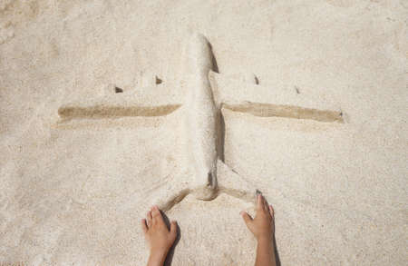 sand mold: The plane of the sand on the beach girl hands