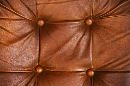 brown leather sofa: Closeup texture of vintage brown leather sofa for background.