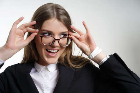 oncept: Portrait of a girl in glasses with a big smile teeth. ? Oncept of healthy vision.