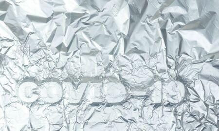 Covid-19 text, coronavirus theme background, 3d word on folded foil