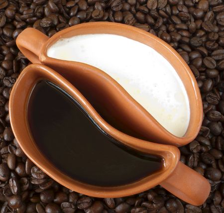 implies: Concept image of coffee and milk. This implies that there may be either jointly or alone Stock Photo