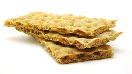 inaccurate: Three crispbread of Rye flour. Inaccurate stack. Isolated on white background. Stock Photo